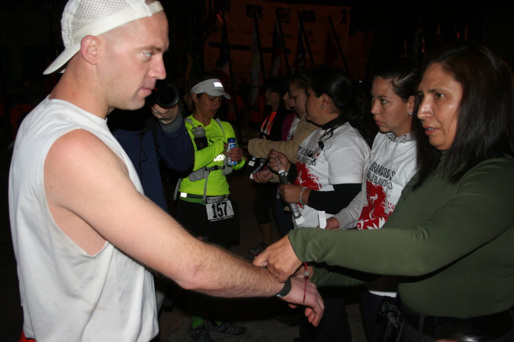 Wil Harlan gets his first wrist band before dawn at the 2013 Caballo Blanco race in Copper Canyon.