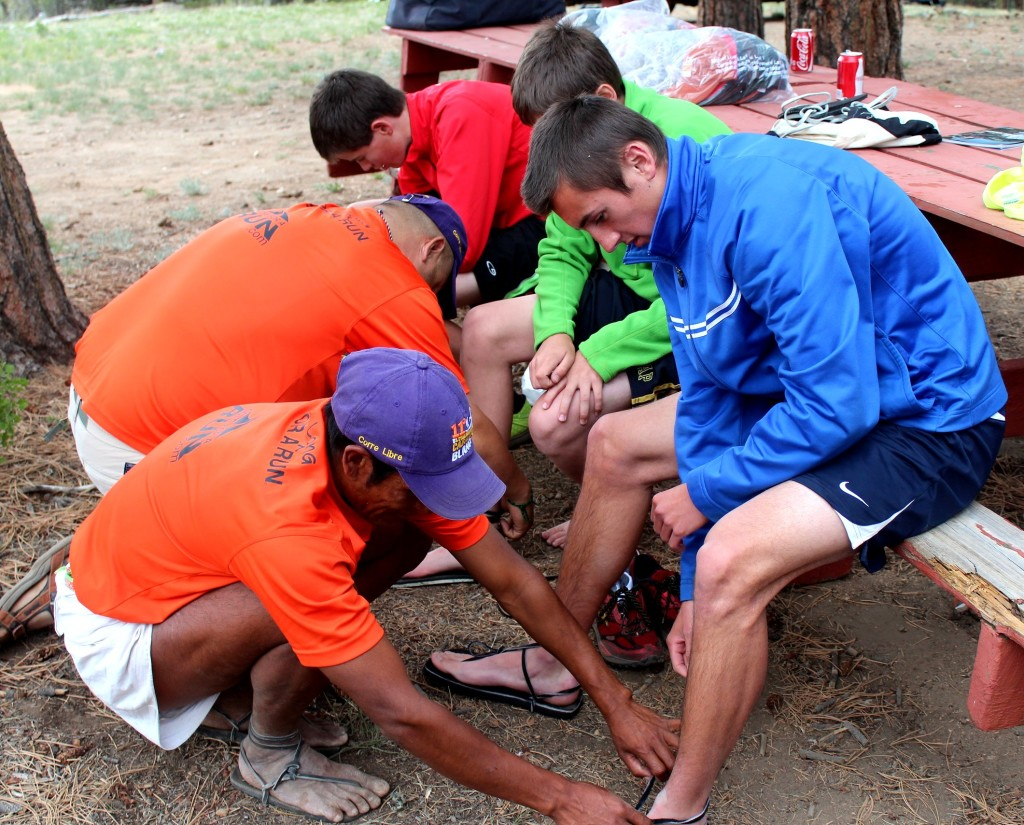 Local high school runners got to learn how to wear and tie huarachis.